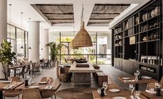 Casa Cook in Rhodes, Greece - shop the look at MIX! - pod lanterns, concrete table, benches and stools.