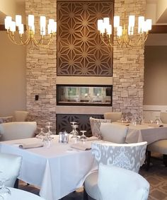 Laser cut screens. Blythefield Country Club, Grand Rapids, Michigan. Room dividers and Fire place, Compass design by Miles and Lincoln. www.milesandlincoln.com