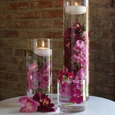 Clear glass cylinder vases. Perfect to fill with stones or gems, even submersible lighting. Find a large selection of wedding decorations at Afloral.com.