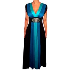 Make a style statement in this stunning maxi dress. Featuring a blue and black colorblock design, plunging neckline, gothic silver belt, and cap sleeves, this dress is eye-catching and bold.