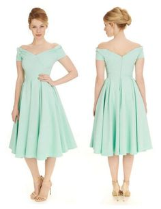 Inspired by Old Hollywood, our Fatale Mint Prom Dress features a flattering full skirt that's given even more definition with the help of a net underskirt #fashion #style #prom #elegant #chic #classic #sophisticated #retro #vintage #mint #pastel #promdress #theprettydress #theprettydresscompany