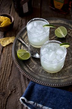 How to Make the Perfect Margarita on the Rocks ~ 1/3 measure (shot glass) simple syrup, 2/3 measure (shot glass) lime juice,  1/3 measure (shot glass) Cointreau,  1 measure (shot glass) Tequila, crushed ice, 1 lime, cut into wedges, and coarse salt to rim the glass.