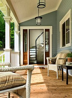 obsessed with porches. also love those stairs