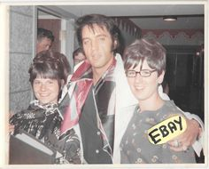 "Elvis Presley photographed with fans backstage at the International Hotel in Las Vegas, NV on Thursday, August 21, 1969 around 3:30am. Elvis has just finished his 8-20-1969 midnight show and is apparently ""roaming the halls"" at 4 in the morning."