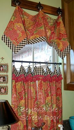 handkerchief valence...how cool its that?  how about using real handkerchiefs or scarfs...that would be super cool