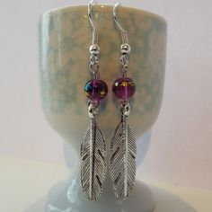 Silver feather and pink bead earrings from Silver Moon Handmade Jewellery & Art by DaWanda.com