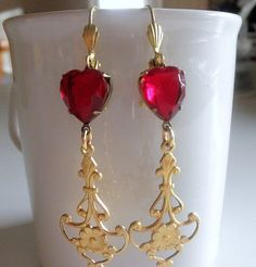 A gorgeous pair of earrings just in time for Valentines or anytime of the year. The ruby hearts against the raw brass is to die for...the color