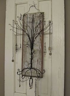 Sassytrash: Primitive jewelry tree. Take one chippy old door panel......add a twisty wire tree......and you have a funky and functional jewelry holder for hanging on the wall.