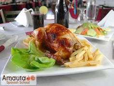 Pollo a la Brasa. (Peruvian chicken)  I recommend you to go to your nearest Peruvian restaurant and try it! :-)