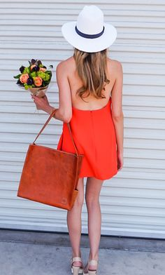 Perfect outfit for the 4th of July | red sundress, brown leather tote and white and navy fedora