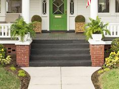 Porch floor: Francesca by Martha Stewart; Siding and trim: White Dove by Benjamin Moore; Front door: Putting Green by Valspar