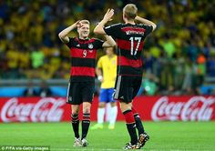 In reserve: Per Mertesacker (R) and Andre Schurlle provide superb options for Joachim Low's germany