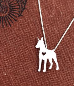Doberman Pinscher necklace, sterling silver hand cut pendant with heart, tiny dog breed jewelry by JustPlainSimple on Etsy https://www.etsy.com/listing/193627643/doberman-pinscher-necklace-sterling