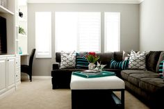 Dark brown sectional with lots of white, gray, and blue.