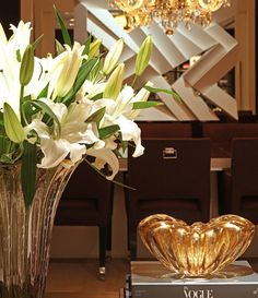 luxurious touches of gold; beautiful clear and gold Venetian glass vase and bow