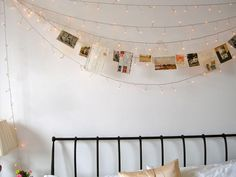 Totally awesome idea with #fairylights and photographs strung over a bed.