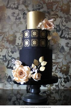 gold and navy blue wedding cake / http://www.himisspuff.com/navy-blue-and-gold-wedding-ideas/3/