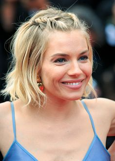 Sienna Miller with matching hair twists, natural makeup and nude lips on May 24.