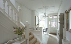 This simply beautiful Edwardian home in England is really perfection! Where  to begin... the stain glass windows, the moldings, the chandeliers, Mora  clock and those panelled walls....wow! The smallish rooms feel much larger  with the use of cream on the walls and white on those incredibly high
