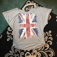 British Crop Top It's a super cute crop top - especially when paired with dark jeans and a cute pair of boots! Only worn a couple times but you can't tell as it has no tearing or holes! It's slightly longer in the back - a slight high low. Almost Famous Tops Crop Tops