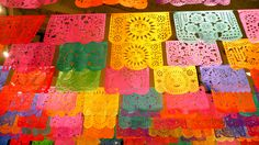"papel picado, translates to ""perforated paper"". Mexican paper-craft flags. Oh the colour!"