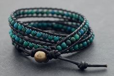 ♥100 % HAND WOVEN IN THAILAND This is leather wrap bracelet made with black genuine leather cord weaved together chrysocolla stone . Closure using large size brass bead with 3 step loop for size adjustment . ♥ lightweight and comfortable to wear ♥ Bracelet measures 23 inch long and has a