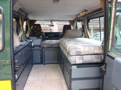 Land Rover Defender 110 camper interior with bed and fridge Landrover Defender, Land Rover Defender Camping, Land Rover Defender Interior, Landrover Camper, Defender Camper, Land Rover Defender 110, Diy Van Camper, Tiny Camper Trailer, Teardrop Camper Interior