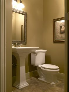 I like the sleek pedestal sink and the soothing lighting in this ...