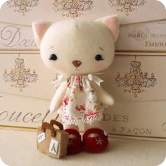 :: Crafty :: Doll :: Animalia :: An irresistible little plush kitten who just loves to explore! Pattern includes instructions for the Kitty, her dress and shoes and her suitcase