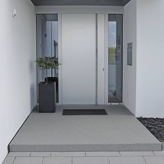 This modern white pivot door is crisp and clean and blends in with the white walls. Find out more about pivot doors OR design your own at http://www.pivotdoorcompany.com/Exterior-Doors/.