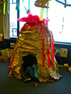 This is a volcano that I made at work! It's made from 2 cardboard boxes, packaging paper, paint, tissue paper and streamers, plus A LOT of tape!