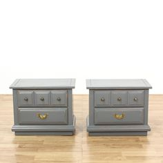"This ""Lea"" pair of nightstands is featured in a solid wood with a grey paint finish. Each shabby chic style bedside table has 2 spacious drawers, beveled panels, and carved trim. Perfect for storing nighttime necessities! #shabbychic #dressers #nightstand #sandiegovintage #vintagefurniture"