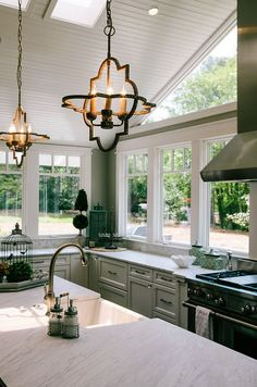 Another view of this amazing kitchen.  Beadboard on the ceiling, skylights, and those precious lights.