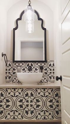sophisticated tiled black and white bathroom. So in love!