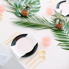 Beyond obsessed with @studiodiy's Palm Fronds + Bon Bons dinner party  She used pineapples + palm fronds to run the table and strung pink + white balloons to add overhead ambiance. #lovemealuau #maitaitime