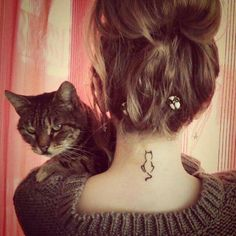 Back of the neck cat tattoo
