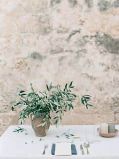 wedding sparrow | olive inspired italian wedding | the table | minimalist wedding | italian wedding ideas | olive branch centerpiece | wedding table decor | place setting