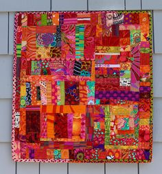 "Finished ... an arty piece using tiny scraps of Kaffe Fassett fabrics left over from other projects. Some are as small as 1"" square. We started this one during a visit back in November.  18""x20""."