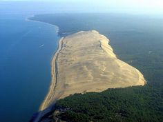 """The Great Dune of Pyla (or Pilat) is the tallest sand dune in Europe. It is located in La Teste-de-Buch in the Arcachon Bay area, France, 60 km from Bordeaux. Pilat is often spelled Pyla, hence the alternative name """"dune of Pyla"""". More accurately, Pyla is Places To Travel, Places To See, Europa Tour, Best Beaches In Europe, Le Pilates, Cap Ferret, The Dunes, France Travel, Places Around The World"""