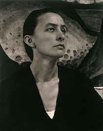 Georgia Totto OKeeffe (November 15, 1887 – March 6, 1986) was an American artist.  Born near Sun Prairie, Wisconsin, OKeeffe first came to the attention of the New York art community in 1916. She made large-format paintings of enlarged blossoms, presenting them close up as if seen through a magnifying lens. OKeeffe has been recognized as the Mother of American Modernism.