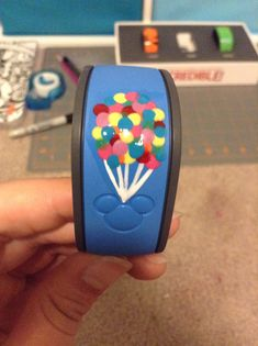 My magic band decorated like disneys UP