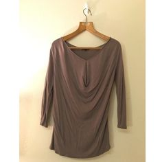 Gap Blouse Taupe colored blouse from Gap. Super flattering neckline design. Material is super soft. Very small spots on front but the gathered cloth hides them completely. GAP Tops Blouses