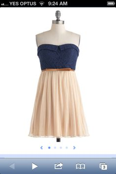 Navy top Cream skirt Brown belt