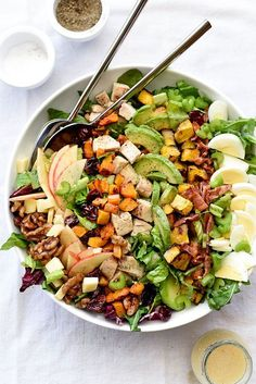 Roasted squash, crunchy apples and dried cherries add seasonal freshness dressed in a spiced apple cider vinaigrette and topped with candied walnuts. healthy + tasty   http://FoodieCrush.com