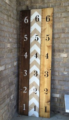 Hand-painted wooden growth chart ruler to hang on the wall. The ruler measures 1x8x6.: