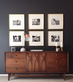 Great combination of retro furniture and simple pictures in frames . Large picture mounts focus the eye on the image.
