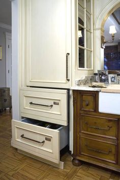Two dishwasher drawers nest inconspicuously behind two identical cabinet facades.
