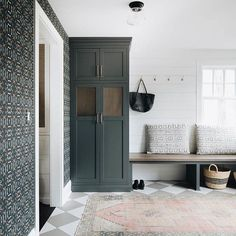 modern farmhouse mudroom with simple bench and shiplap with hooks, black cabinets, black locker storage with wallpaper in modern mudroom design and boho rug, modern minimal mudroom decor Decor, Furniture, Mudroom, Mudroom Decor, Interior, Simple Benches, Mudroom Design, Home Decor, House Interior