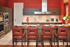 A high-rise Austin condo's #modern red #kitchen. | See MORE at www.luxesource.com. | #luxemag #interiordesign #design #interiors #homedecor