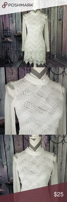 Knit Open Back Dress Knitted white dress. Zips and buttons on back. Poly/ spandex blend. Charlotte Russe Dresses
